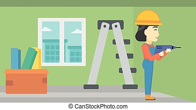 Constructor with perforator - An asian female worker...
