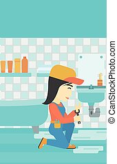Woman repairing sink - An asian female plumber sitting in a...