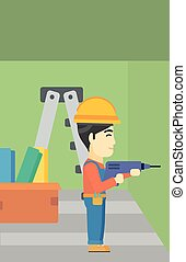 Constructor with perforator - An asian worker drilling a...