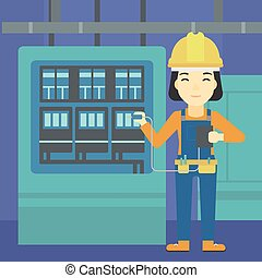 Electrician with electrical equipment. - An asian woman in...