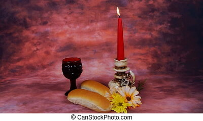 Sabbath image. challah bread, candelas on wooden table....