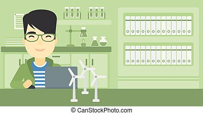 Man working with model wind turbines on the table. - An...