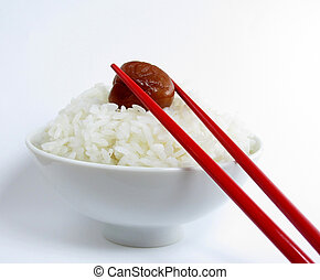Bowl of white rice with ume and red chopsticks - Bowl of...