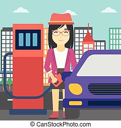 Worker filling up fuel into car - An asian woman filling up...