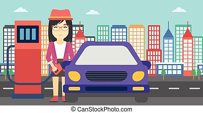 Worker filling up fuel into car. - An asian woman filling up...