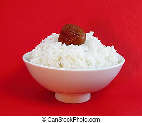 Bowl of white rice with ume - White bowl of white rice with...