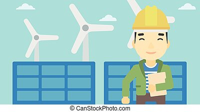 Male worker of solar power plant and wind farm - An asian...