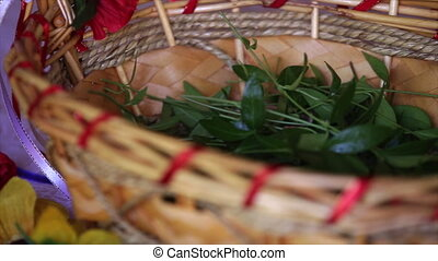 periwinkle leaves in a wicker basket. - periwinkle leaves in...