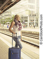 Woman waiting for the train - Woman at platform waiting for...