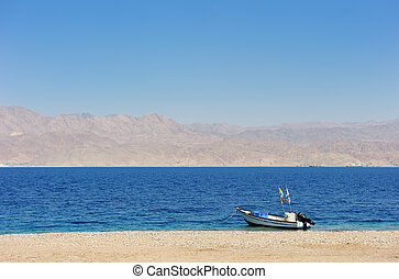 Red Sea - Gulf of Eilat Red Sea, the boat on the shore and...