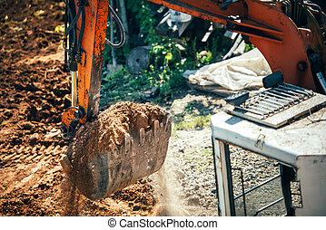 industrial excavator moving earth on construction site....