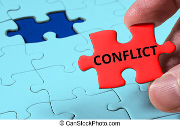 Close up of Red jigsaw puzzle with Conflict word, business...