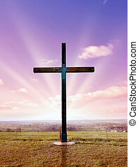 christian cross at sunset or sunrise - christian cross of...