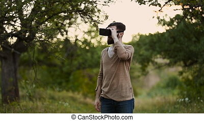 man with glasses of virtual reality in nature