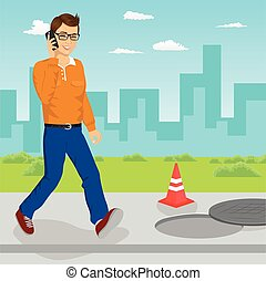 Man walking into open manhole looking at his smartphone...