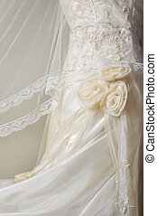 Wedding Gown - Close-up of white wedding gown on plain...