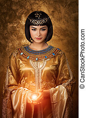 Beautiful Egyptian woman like Cleopatra with magic ball on...