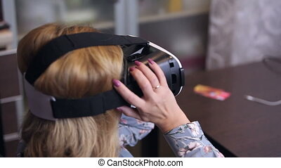 Woman wearing virtual reality 3D headset
