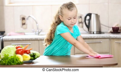 Little girl wiping the table