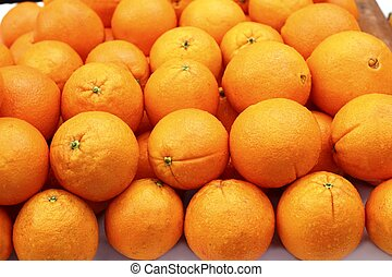 stacked orange fruits rows arranged in market Valencia Spain