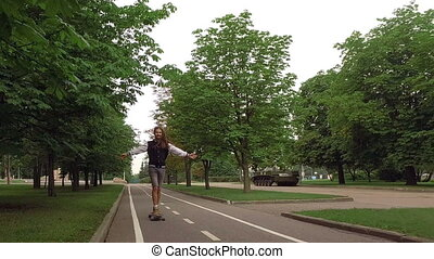 cool guy on his longboard skate in a great park