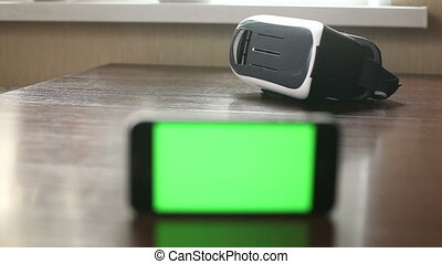 3D headset and a mobile phone on the table