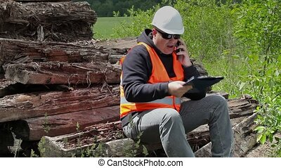 Angry worker sitting and talking on