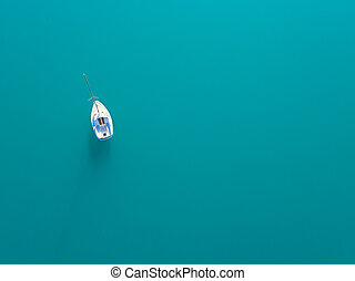 Aerial view of alone yacht sailling on azure water -...