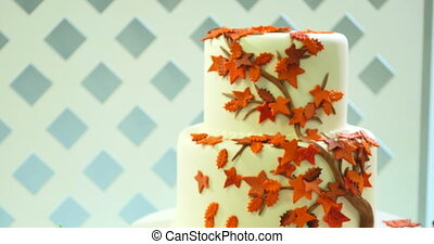 wedding cake decorated with yellow autumn leaves