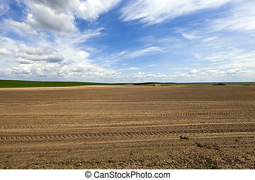 plowed agricultural land - agricultural field, which was...