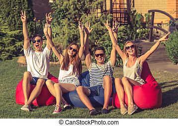 Young people resting outdoors - Young beautiful people in...