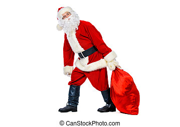 Santa Claus - Funny Santa Claus with an effort pulls sack...