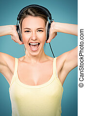 loud music - Modern girl enjoys listening to music in...