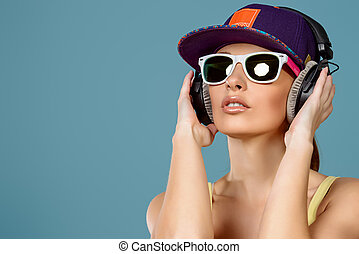 radio music - Modern young woman enjoys listening to music...