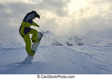 snowboarder does the trick raises the front of the board....