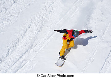 Snowboarder riding on loose snow Freeride top view