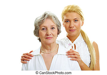 Together - Portrait of attractive woman touching her old...