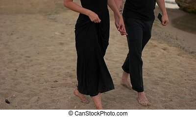 Couple walking on the sand