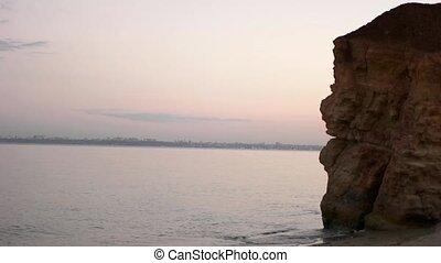 A sand beach with rocks
