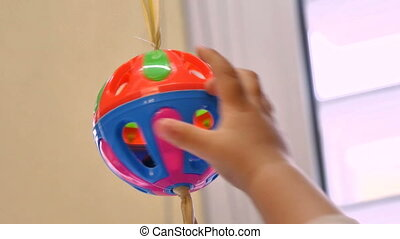 Baby Playing with a Rattle - Toddler pulling the ball...
