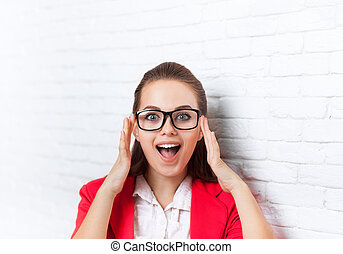 Businesswoman excited wear red jacket glasses happy smiling...