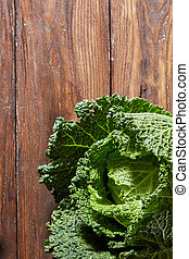 Green savoy cabbage - Savoy Cabbage close-up shot on wooden...