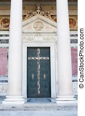 St Paul basilica holy door in Rome with column, closed door...