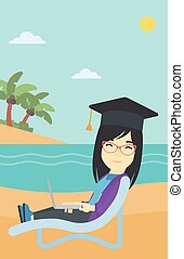 Graduate lying in chaise lounge with laptop - An asian happy...