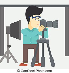 Photographer working with camera on tripod.