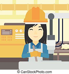 Woman working on industrial drilling machine. - An asian...