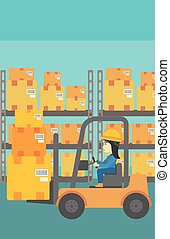 Warehouse worker moving load by forklift truck - An asian...