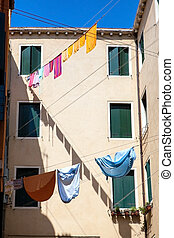 Venetian buildings in Italy - Laundry drying on clothesline...