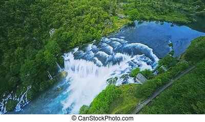 Waterfall flow aerial shot - Copter aerial view of the...