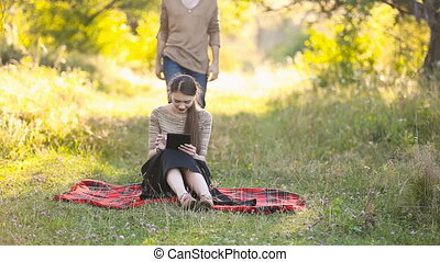 man closes his eyes with hands Girl in nature
